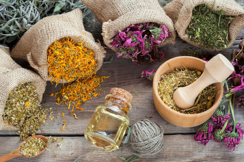 healing herbs in bags - chamomile essential oil for skincare